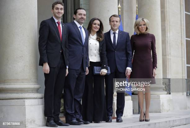 French President Emmanuel Macron and his wife Brigitte Macron welcome Lebanese Prime Minister Saad Hariri his wife Lara Bachir ElAlzm and their son...