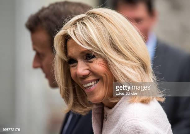 French President Emmanuel Macron and his wife Brigitte MarieClaude Macron arrive for the International Charlemagne Prize ceremony on May 10 2018 in...