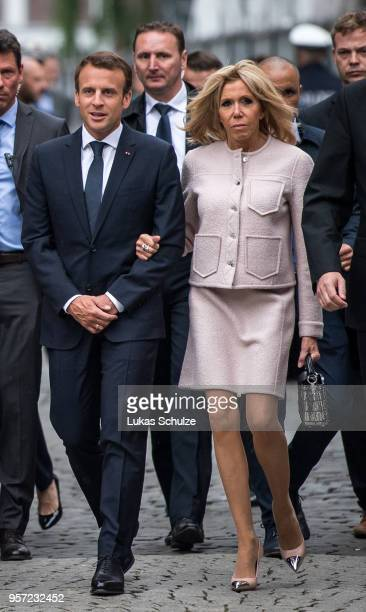 French President Emmanuel Macron and his wife Brigitte MarieClaude Macron arrive for the International Charlemagne Prize on May 10 2018 in Aachen...
