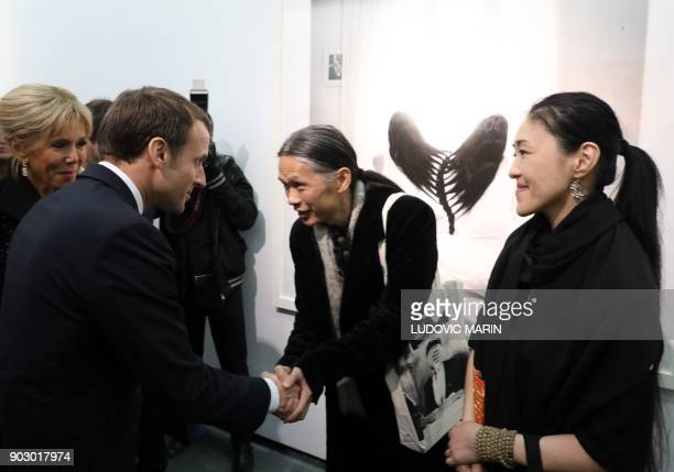 French President Emmanuel Macron and his wife Brigitte meet artists as they visit The Ullens Chinese Contemporary Art Centre in Beijing on January 9...