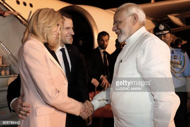 French President Emmanuel Macron and his wife Brigitte meets Indian Prime minister Narendra Modi on March 9 2018 at New Delhi's military airport as...