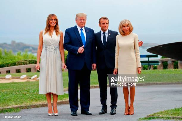 TOPSHOT French President Emmanuel Macron and his wife Brigitte pose with US President Donald Trump and US First Lady Melania Trump at the Biarritz...
