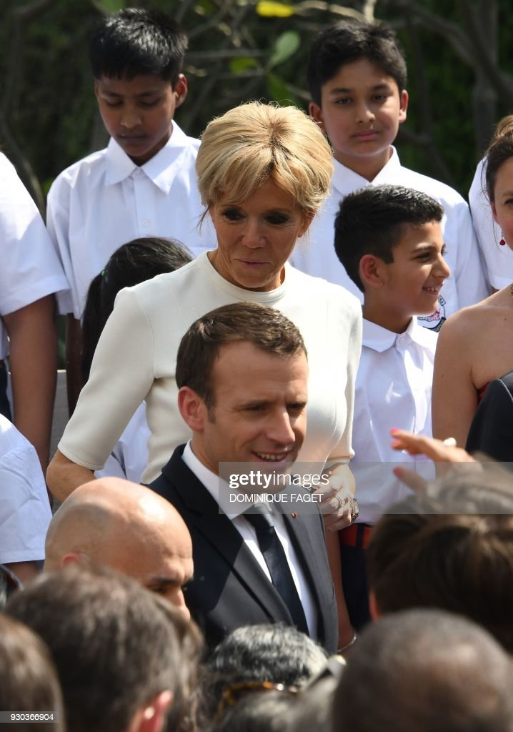 French President Emmanuel Macron and his wife Brigitte smile during a meeting with the French community resident in India at the French embassy in New Delhi on March 11, 2018. French President Emmanuel Macron on March 10 said he wanted his country to be India's best partner in Europe as he started a three-day trip to the country aimed at ratcheting up security and energy ties. /