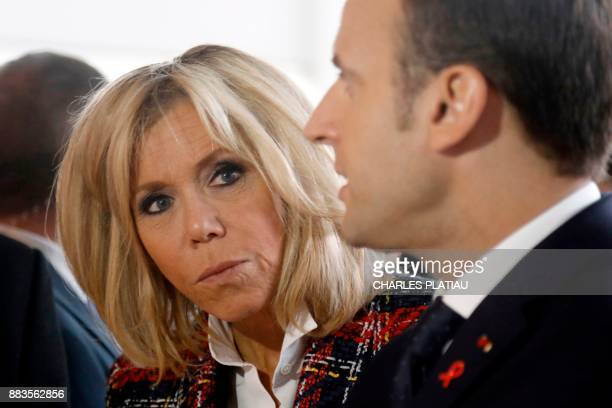 French President Emmanuel Macron and his wife Brigitte talk with medical staff as they visit the Delafontaine Hospital in SaintDenis near Paris as...