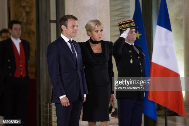French President Emmanuel Macron and his wife Brigitte Trogneux welcome their guests for a State dinner offered in honor of Lebanese President Michel...
