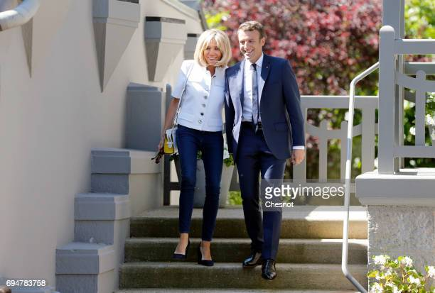 French President Emmanuel Macron and his wife Brigitte Trogneux leave their home prior to their vote at the polling station of the town hall in the...