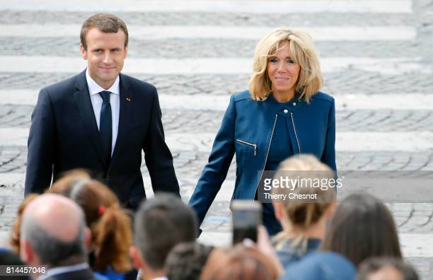 French President Emmanuel Macron and his wife Brigitte Trogneux attend the traditional Bastille day military parade on the ChampsElysees on July 14...