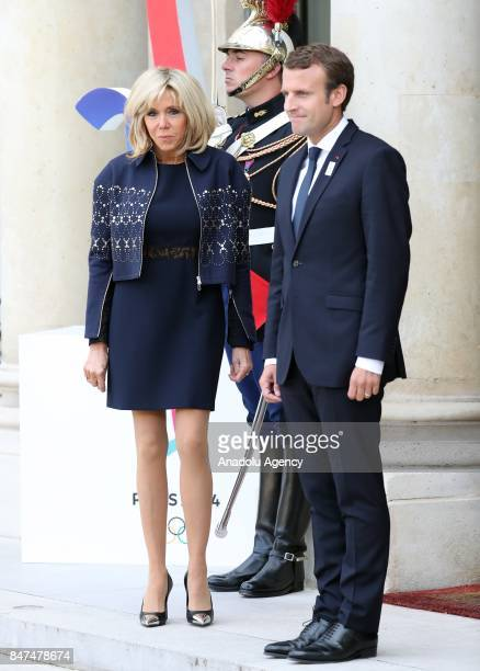 French President Emmanuel Macron and his wife Brigitte wait for former French Presidents for Paris 2024 Olympic City reception at Elysee Palace in...