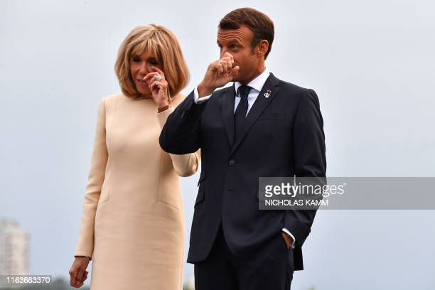 French President Emmanuel Macron and his wife Brigitte wait to welcome world leaders at the Biarritz lighthouse southwestern France ahead of a...