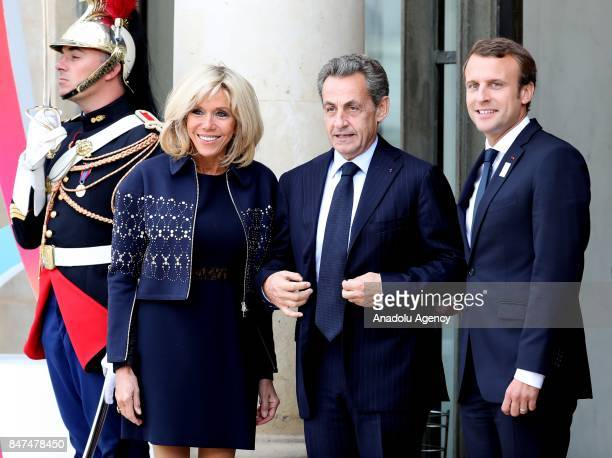 French President Emmanuel Macron and his wife Brigitte welcome former French President Nicolas Sarkozy for Paris 2024 Olympic City reception at...