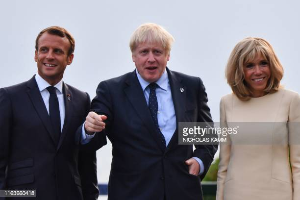 French President Emmanuel Macron and his wife Brigitte welcome Britain Prime Minister Boris Johnson at the Biarritz lighthouse southwestern France...