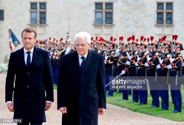 French President Emmanuel Macron and Italian President Sergio Mattarella walk past French Republican guards prior to a ceremony to commemorate the...