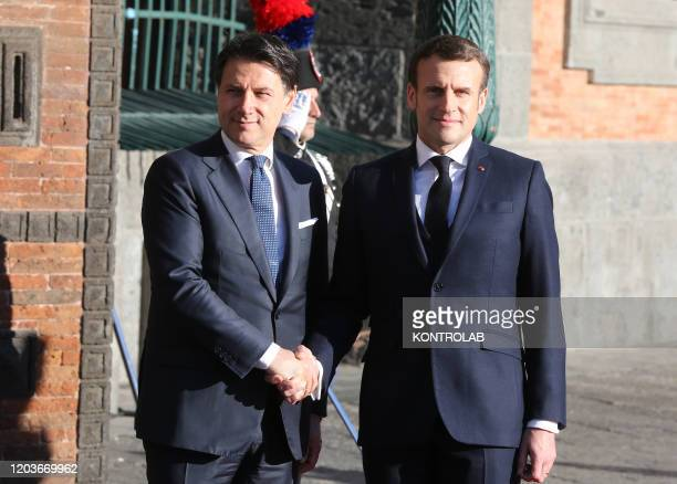 French President Emmanuel Macron and Italian Prime Minister Giuseppe Conte shake hands next to the Royal Palace, venue of the XXXV Italian-French...
