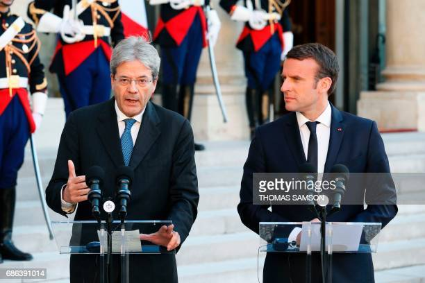 French President Emmanuel Macron and Italian Prime Minister Paolo Gentiloni deliver a joint press briefing during their meeting at the Elysee Palace...