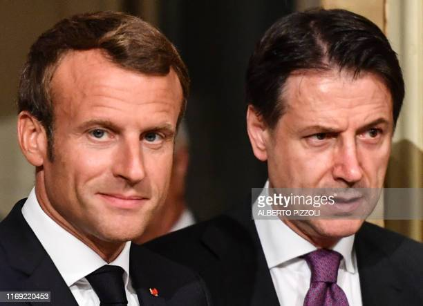 French President Emmanuel Macron and Italy's Prime Minister Giuseppe Conte arrive to hold a joint press conference following their meeting on...