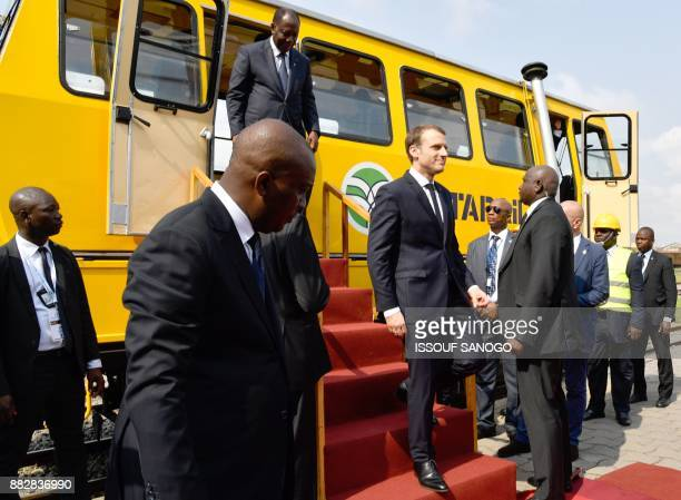 French President Emmanuel Macron and Ivory Coast President Alassane Ouattara attend a ceremony for the start of the construction of the first metro...