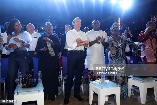 French President Emmanuel Macron and Lagos Governor Akinwunmi Ambode dance at the Afrika Shrine in Lagos on July 3 2018 French President Emmanuel...