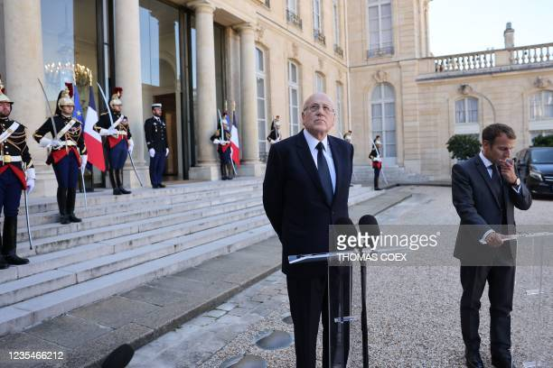 French President Emmanuel Macron and Lebanese Prime Minister Najib Mikati speak to the press after a working lunch at the Elysee Palace, in Paris, on...