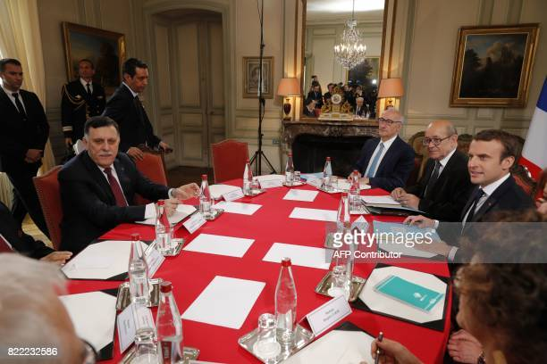 French President Emmanuel Macron and Libyan Prime Minister Fayez al-Sarraj attend a meeting for talks aimed at easing tensions in Libya, in La...