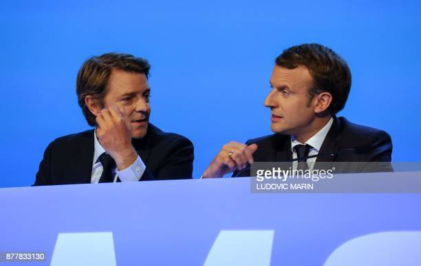 French President Emmanuel Macron and Mayor of Troyes and President of the Association of Mayors of France Francois Baroin attend the 100th French...