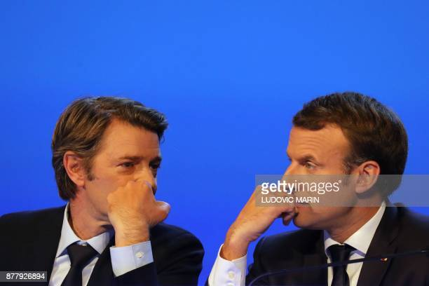 French President Emmanuel Macron and Mayor of Troyes and President of the Association of Mayors of France Francois Baroin speak during the 100th...