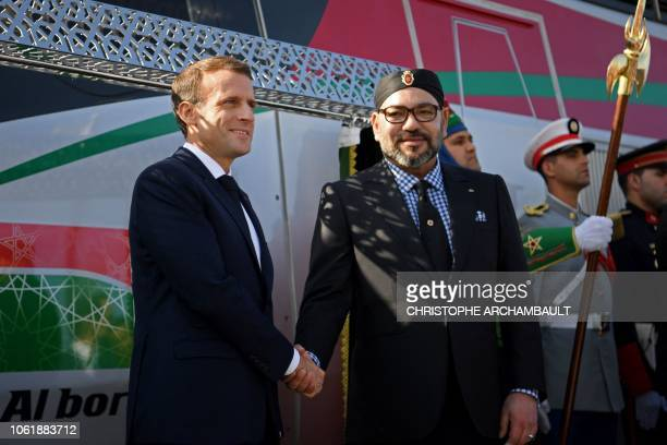 French President Emmanuel Macron and Moroccan King Mohammed VI shake hands as they inaugurate a highspeed line at Tangiers train station on November...