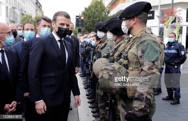 French President Emmanuel Macron and Nice Mayor Christian Estrosi visit the scene of a knife attack at the Basilica of Notre-Dame de Nice in Nice on...