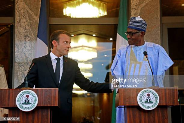 French President Emmanuel Macron and Nigerian President Muhammadu Buhari hold a press conference in Abuja on July 3 2018 French President Emmanuel...