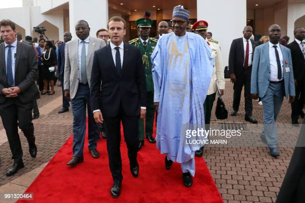 French President Emmanuel Macron and Nigerian President Muhammadu Buhari speak in Abuja on July 3 2018 French President Emmanuel Macron has arrived...