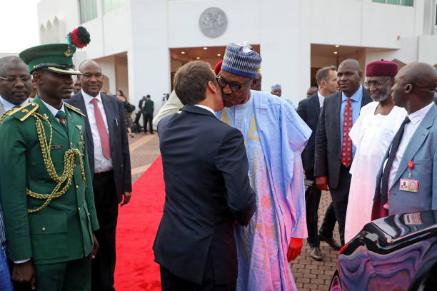 French president emmanuel macron and nigerian president muhammadu french president emmanuel macron and nigerian president muhammadu buhari greet each other in abuja on july m4hsunfo