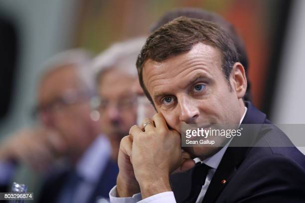 French President Emmanuel Macron and other EU leaders speak to the media following a meeting of European Union leaders at the Chancellery on June 29...