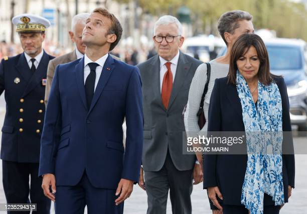 French President Emmanuel Macron and Paris Mayor and Socialist Party candidate for the 2022 French presidential elections Anne Hidalgo pay tribute to...