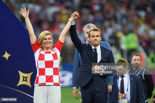 French President Emmanuel Macron and President of Croatia Kolinda Grabar Kitarovic on the podium prior to the winners ceremony following the 2018...