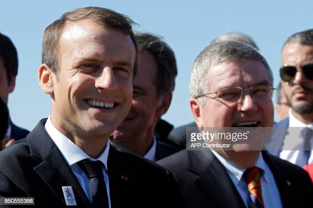 French President Emmanuel Macron and President of the International Olympic Committee Thomas Bach visit the site of the future Olympic Sailing venue...