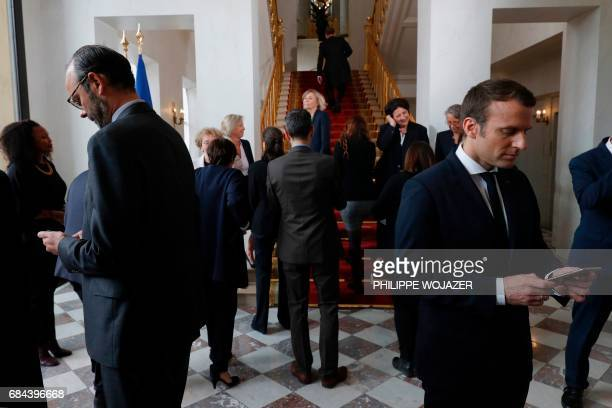 French President Emmanuel Macron and Prime Minister Edouard Philippe leave after a family photo following the first cabinet meeting at the Elysee...