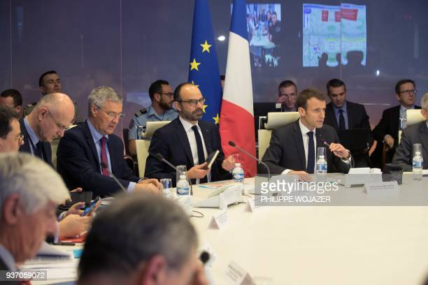 French President Emmanuel Macron and Prime Minister Edouard Philippe attend a videoconference in Paris with Interior Minister Gerard Colomb and...