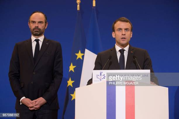 French President Emmanuel Macron and Prime Minister Edouard Philippe arrive to deliver a speech in Paris after a hostage situation in a supermarket...