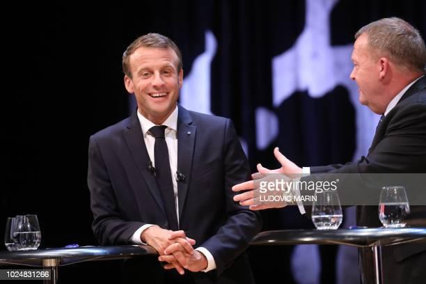 French President Emmanuel Macron and Prime Minister Lars Lokke Rasmussen take part in a debate at the Black Diamond on August 28, 2018 in Copenhagen.