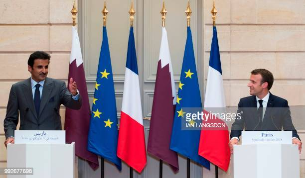 French President Emmanuel Macron and Qatar Sheikh Tamim bin Hamad Al Thani hold a joint press conference after their meeting at the Elysee Palace in...