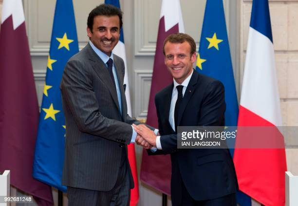 French President Emmanuel Macron and Qatar Sheikh Tamim bin Hamad Al Thani shake hands after holding a joint press conference after their meeting at...