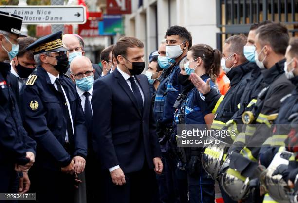 French President Emmanuel Macron and Right-wing party Les Republicains MP Eric Ciotti visit the scene of a knife attack at the Basilica of Notre-Dame...