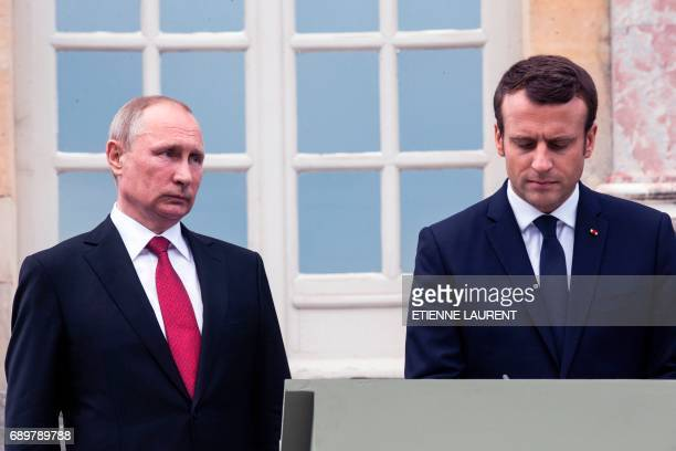 French President Emmanuel Macron and Russian President Vladimir Putin sign the golden book after a visit of an exhibition about Russian emperor Peter...