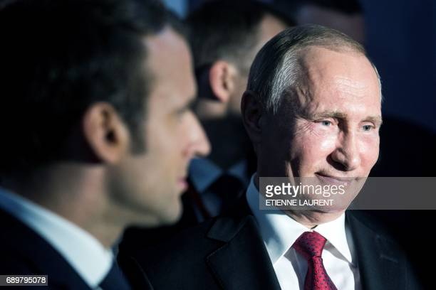 French President Emmanuel Macron and Russian President Vladimir Putin visit an exhibition about Russian emperor Peter the Great at the Grand Trianon...