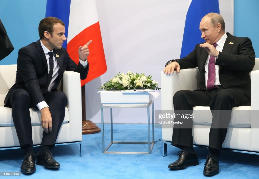 French President Emmanuel Macron (L) and Russian President Vladimir Putin meet during the G20 Summit on July 8, 2017 in Hamburg, Germany. The leaders were reportedly to talk the about climate change and issues surrounding the Ukraine.