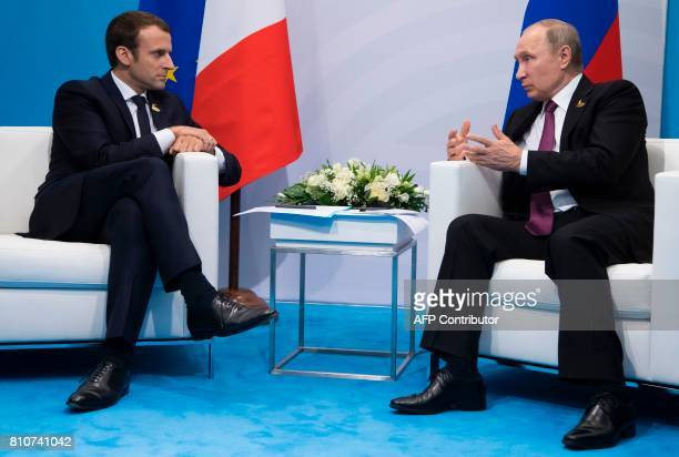 French President Emmanuel Macron and Russia's President Vladimir Putin hold a bilateral meeting on the second day of the G20 summit in Hamburg...