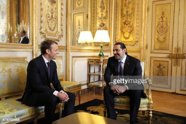 French President Emmanuel Macron and Saad Hariri who announced his resignation as Lebanon's prime minister while on a visit to Saudi Arabia meet for...