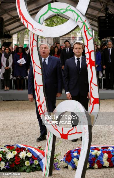 French President Emmanuel Macron and Senate President Gerard Larcher lay wreaths during a ceremony to mark the abolition of slavery and to pay...