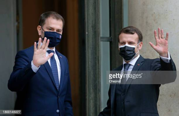 French President Emmanuel Macron and Slovakia's Prime Minister Igor Matovic wave prior to a working lunch at the Elysee Palace on February 3, 2021 in...