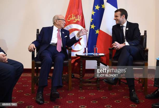 French President Emmanuel Macron and Tunisian President Beji Caid Essebsi talk during a bilateral meeting at the Summit of the Heads of State and of...