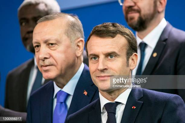French President Emmanuel Macron and Turkish President Recep Tayyip Erdogan are pictured during a family picture at the Chancellery on January 19,...